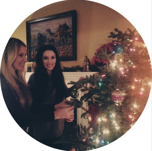 Trimming the tree with my sister, Lauren